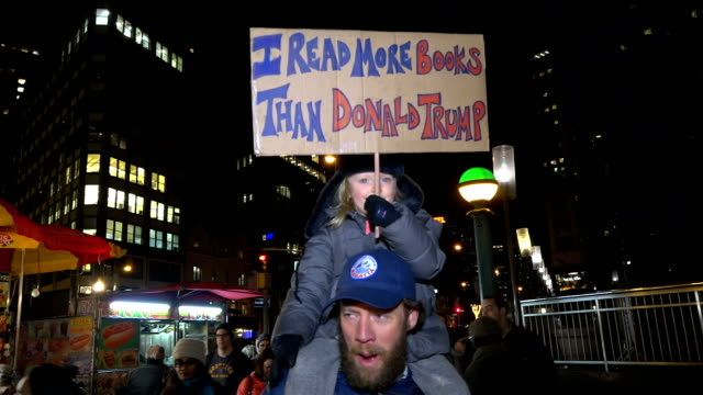 anti donald trump protesters gather in front of the trump international hotel tower in new york city ahead of the us presidentelect's presidential... - organisierte gruppe stock-videos und b-roll-filmmaterial
