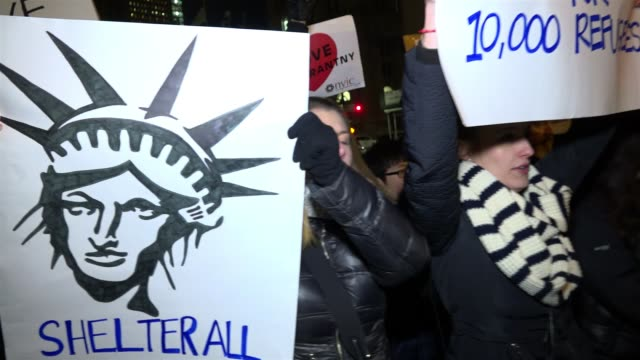 anti - donald trump protesters gathered in foley square – manhattan to protest the controversial executive order signed by president donald trump's... - exclusion stock videos & royalty-free footage
