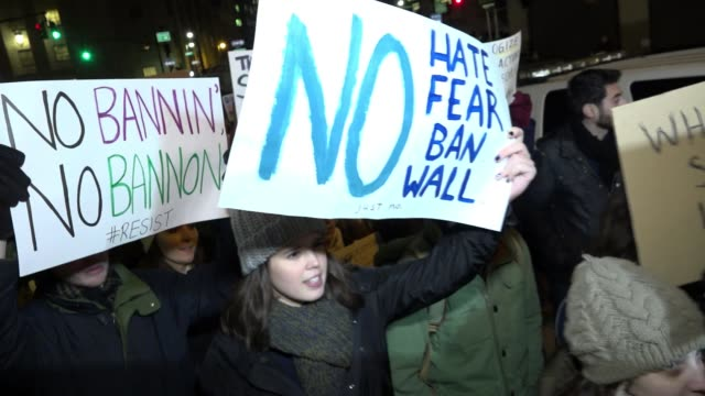 anti - donald trump protesters gathered in foley square – manhattan to protest the controversial executive order signed by president donald trump's... - アフリカの角点の映像素材/bロール