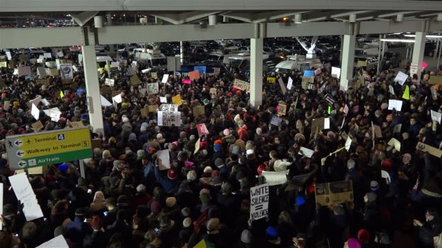 anti - donald trump protesters gathered in jfk in the borough of queens, new york city to protest the controversial executive order signed by... - forbidden stock videos & royalty-free footage