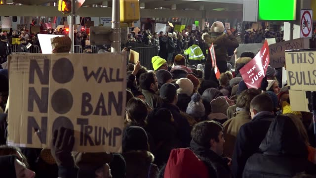 anti donald trump protesters gathered in jfk in the borough of queens new york city to protest the controversial executive order signed by president... - forbidden stock videos & royalty-free footage