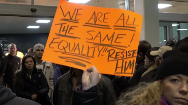 anti donald trump protesters gathered in jfk in the borough of queens new york city to protest the controversial executive order signed by president... - port authority stock videos & royalty-free footage