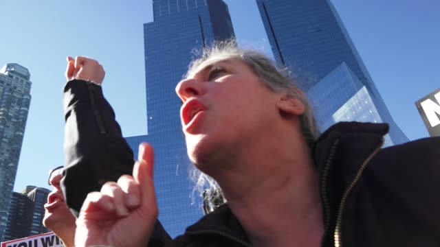 anti – donald trump protesters gathered in the columbus circle 59th street vicinity near the upper west side trump international hotel tower to... - presidents day stock videos and b-roll footage