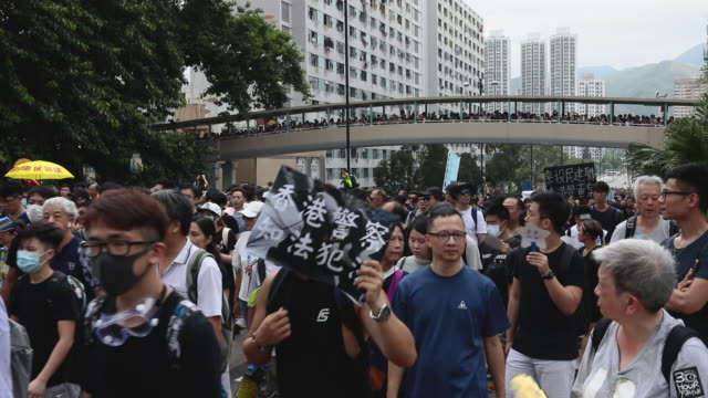 stockvideo's en b-roll-footage met anti extradition law protests take place in sha tin on july 14 2019 in hong kong hong kong prodemocracy demonstrators will continue to protest this... - chanten