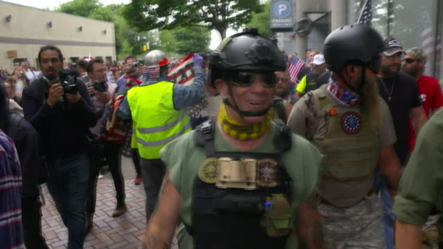 anti fascist protesters kept away from neofascist protesters at white supremacy march in portland oregon - anti fascism stock videos & royalty-free footage