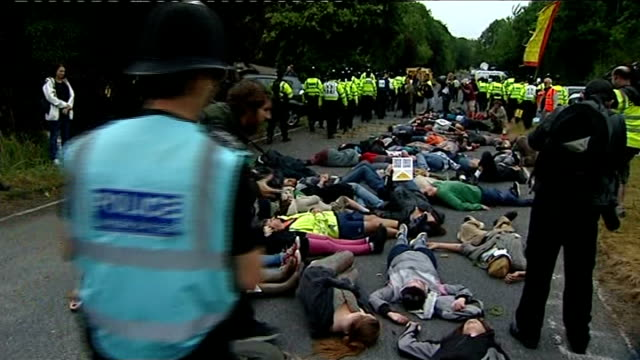 Anti fracking protests continue in Sussex ENGLAND Sussex Balcombe EXT Antifracking protesters lying in road outside Cuadrilla exploratory drilling...
