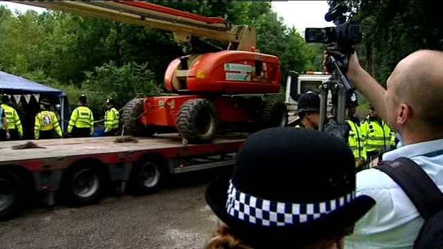 Anti fracking protests continue in Sussex ENGLAND Sussex Balcombe EXT Arrested woman into police van / Protesters beside road / Police escorting...