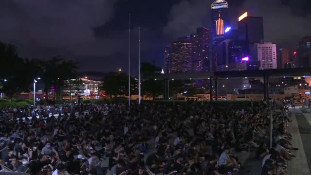 stockvideo's en b-roll-footage met anti government demonstrators gather outside the legislative council building in hong kong demanding the resignation of the city's pro beijing leader... - hong kong