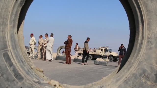 vídeos de stock e filmes b-roll de anti government demonstrators in oil rich basra province in southern iraq shout iran out and block the access route to the port of khor al zubair as... - bassorá