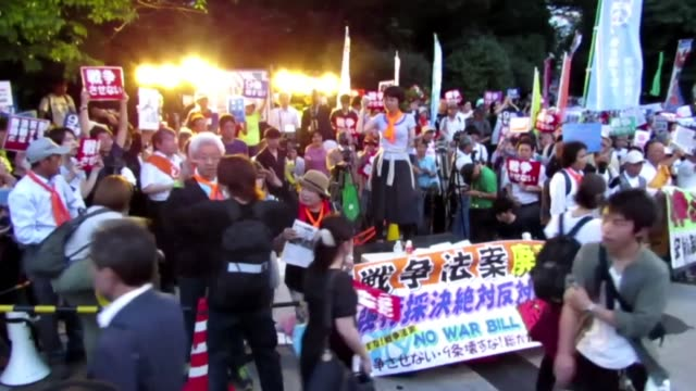 Anti government rally staged outside Japanese parliament to protest against the passing of controversial security bills that opponents say will...
