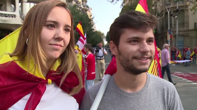 anti independence protesters take to the streets of barcelona on spain's national day amid the ongoing political crisis over catalonia's independence - continuity stock videos & royalty-free footage