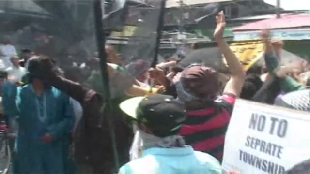 anti india protest rally in indian administered kashmir pakistan isis and leshkartoiba flags furled during protest rally the protest programme was... - pakistan stock videos and b-roll footage