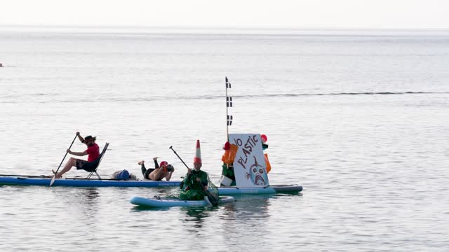 anti plastic campaigners in the sea at a oxfam campaigners pose as g7 leaders as the charity calls on the g7 to commit to cutting emissions further... - brightly lit stock videos & royalty-free footage