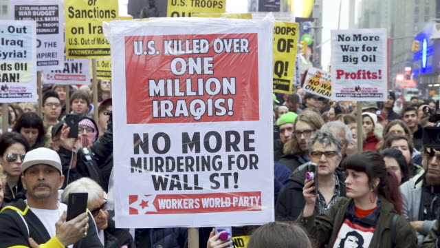 anti president donald trump protest in light of the death and assassination of iranian major general qasem soleimani demonstrators rallied at father... - friedensdemonstration stock-videos und b-roll-filmmaterial