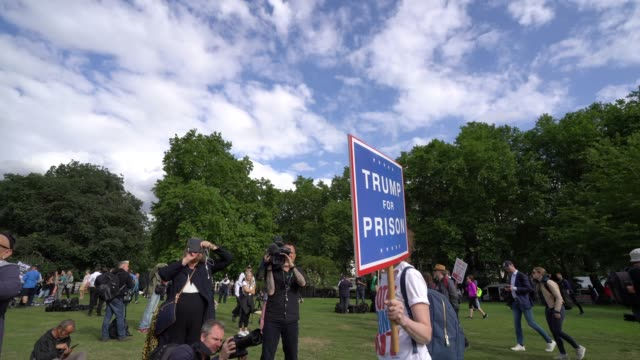 anti trump protester holds a sign calling for his imprisonment at protests against president donald trump on june 3 2019 in london england - donald trump us president stock videos and b-roll footage