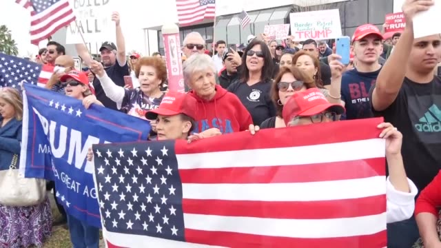 anti trump protesters as well as trump supporters gather along opposite sides of the street in mcallen texas awaiting the arrival of donald trump who... - mcallen texas stock videos & royalty-free footage
