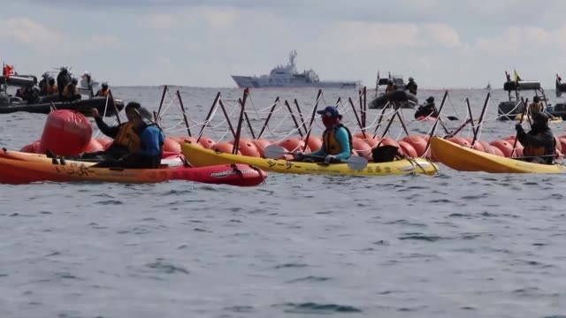 Anti US military base protesters in motor boats and kayaks disrupt the preparation for the construction of the new US Marine Airbase in Oura Bay Camp...