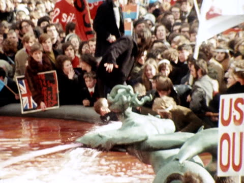 anti vietnam war protestors clash with policemen at a rally in trafalgar square - vietnamkrieg stock-videos und b-roll-filmmaterial
