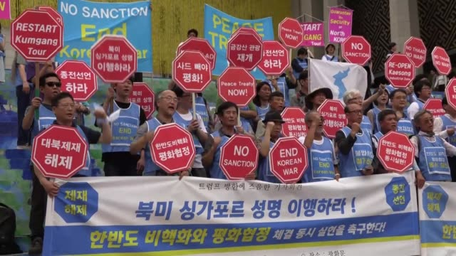 anti war activists in seoul urge us president donald trump to carry out the north korea us joint agreement signed in singapore - donald trump us president stock videos and b-roll footage