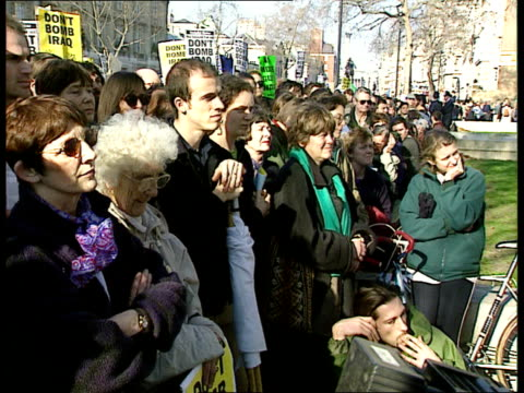 stockvideo's en b-roll-footage met anti war demos/chemical weapons; england: london: whitehall: lms protestors holding placards and chanting sot police holding back protestors... - british military
