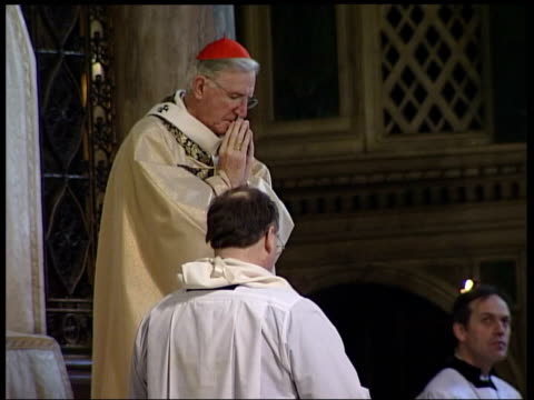 anti war statements: brit awards / archbishop of canterbury; london: westminster cathedral: cardinal cormac murphy-o'connor praying congregation - westminster cathedral stock videos & royalty-free footage