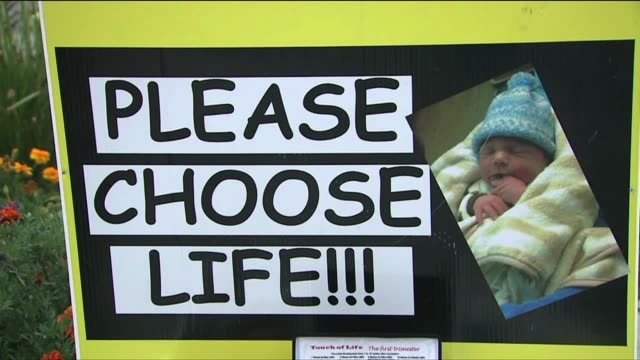 antiabortion signs outside of abortion clinic - clinic stock videos and b-roll footage