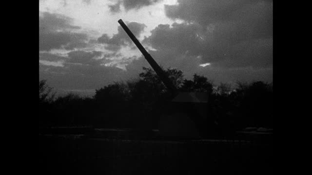 montage anti-aircraft guns, empty sky, firemen, air raid wardens, and ambulance drivers watching the sky and turning on searchlights / london, england, united kingdom - allied forces stock videos & royalty-free footage