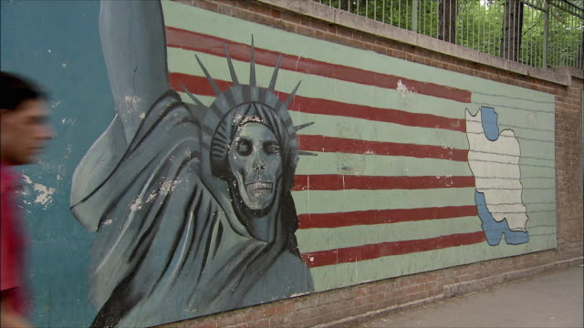 ms anti-american mural with statue of liberty on wall in front of united states embassy, tehran, iran - tehran stock videos and b-roll footage