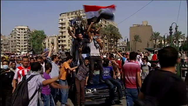 anti-american protests in yemen and egypt over anti-islam film; egypt: cairo: ext tear gas being fired towards protesters in street low angle view of... - arab spring stock videos & royalty-free footage