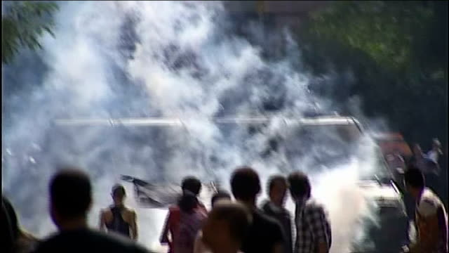 anti-american protests in yemen and egypt over anti-islam film; ext protesters with tear gas rising in background - arab spring stock videos & royalty-free footage