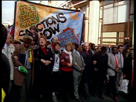a england london black white demos along lr with sanctions now banner with glenys kinnock norman willis trevor huddleston others at head of march... - back to front stock videos & royalty-free footage