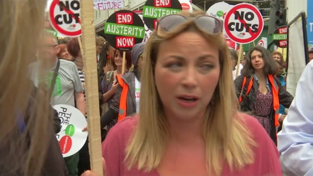 anti-austerity march in london; protesters including charlotte church along with banner at front of protest march protesters marching along zoom in... - charlotte church stock videos & royalty-free footage