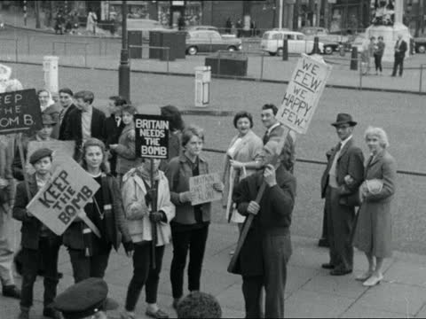 "anti-bomb marchers; 9.00pm story england: marchers along carrying international signs man - dark glasses past cms people along cyprus"" banner past... - itv evening bulletin stock videos & royalty-free footage"