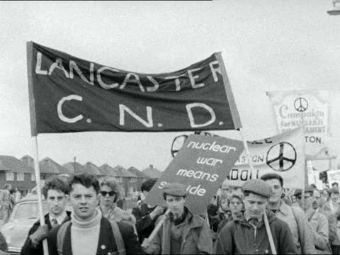 anti-bomb marchers; england: gv procession along with slogans cms procession past cms more more past - boy past woman in headscarf past man with... - itv evening bulletin stock videos & royalty-free footage