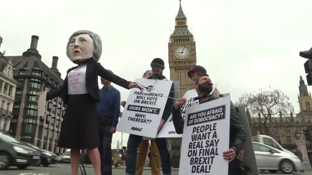 AntiBrexit activists stage a stunt outside the British parliament urging Prime Minister Theresa May to listen to the entire country and saying we...