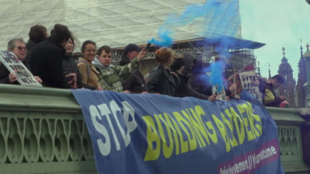 antibrexit protesters holding up a banner saying 'stop building borders' during a demonstration in london - emigration and immigration stock videos & royalty-free footage
