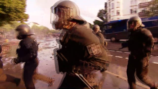 anticapitalist demonstrators clash with police on the streets of hamburg germany g20 protests water canon - demonstrant stock-videos und b-roll-filmmaterial