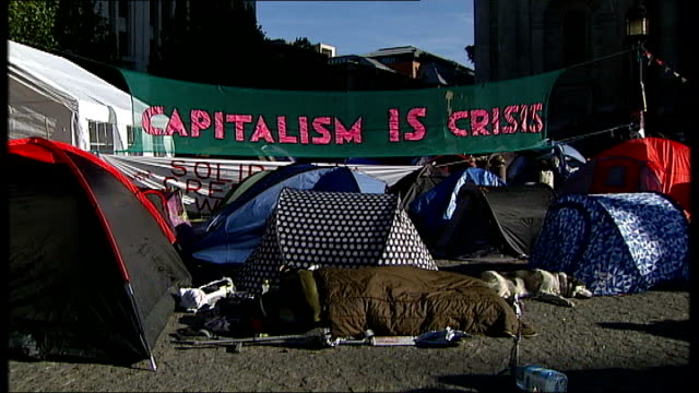 anticapitalist protest keeps st paul's cathedral closed england london st paul's cathedral ext low angle gv st paul's cathedral tilt down to... - plucking an instrument stock videos and b-roll footage