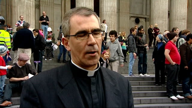 anticapitalist protest outside st paul's cathedral legal action to end protest members of clergy standing at pulpit during prayers unidentified... - minister clergy stock videos and b-roll footage