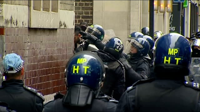anticapitalist protests ahead of g8 summit police enter building england london beak street some sound interference over this clip gvs riot police... - 機動隊点の映像素材/bロール