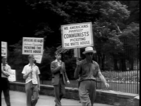 pan anticommunist protesters marching in front of white house / newsreel - comunismo video stock e b–roll