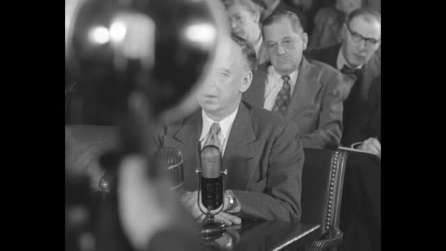 """vídeos de stock, filmes e b-roll de anti-communist/former communist louis budenz takes oath as he begins testimony before the tydings committee; sot he testifies: """"from 1935 to 1945, i... - anticomunismo"""
