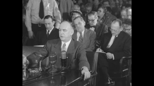 vídeos de stock e filmes b-roll de sot anticommunist/former communist louis budenz testifies before the tydings committee speaking of a 1943 meeting with earl browder cites frederick... - anticomunismo