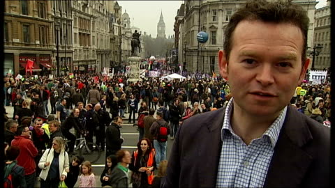 anti-cuts 'march for the alternative': hundreds of thousands take part; mass crowds along up whitehall, waving flags and banners 'coalition... - 労働組合会議点の映像素材/bロール