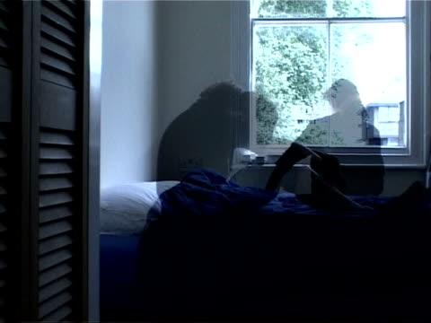 anti-depressant seroxat can increase the risk of suicide; graphicised sequence woman on bed in darkened room - anti depressant stock videos & royalty-free footage