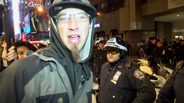 anti-donald trump protest outside of the grand hyatt hotel / a small group of people claiming to be occupy wall street continued to protest after the... - assertiveness stock videos & royalty-free footage
