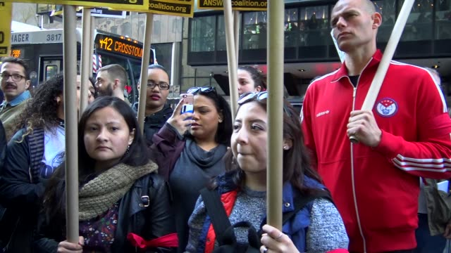 anti-donald trump protest outside of the grand hyatt hotel and grand central station / 42nd street, midtown manhattan, new york city, usa - 42nd street stock videos & royalty-free footage