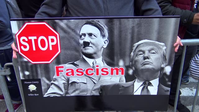 AntiDonald Trump protest outside of the Grand Hyatt Hotel and Grand Central Station / 42nd Street Midtown Manhattan New York City USA / Poster of...