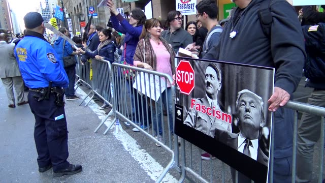 AntiDonald Trump protest outside of the Grand Hyatt Hotel and Grand Central Station / 42nd Street Midtown Manhattan New York City USA