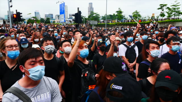 antiextradition bill protesters gather outside the central government complex where carrie lam's office is located protesters are angry she has not... - sprechgesang stock-videos und b-roll-filmmaterial